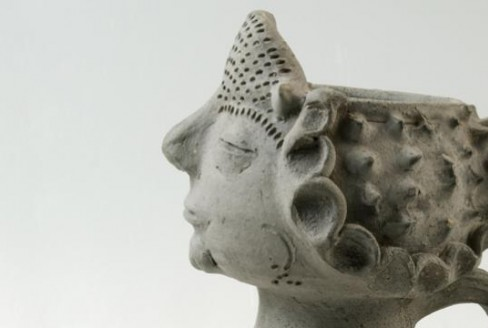 Female head moulded on a pot or jug